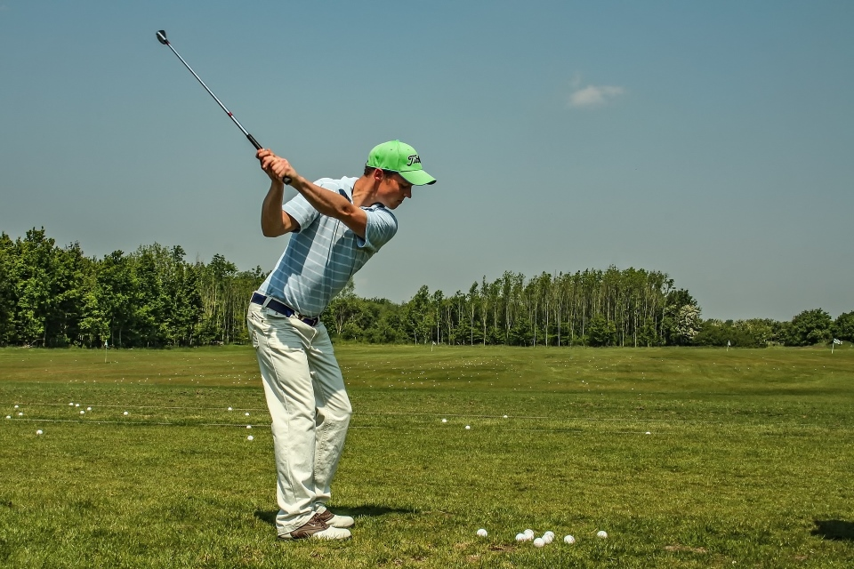 Guy making a backswing